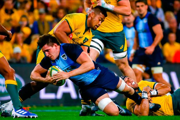 Argentina's Tomas Lavanini (R) is tackled by Australia's Christian Lealiifano (L) during the Rugby Championship match between Australia and Argentina at Suncorp Stadium in Brisbane on July 27, 2019. (Photo by Patrick HAMILTON / AFP)