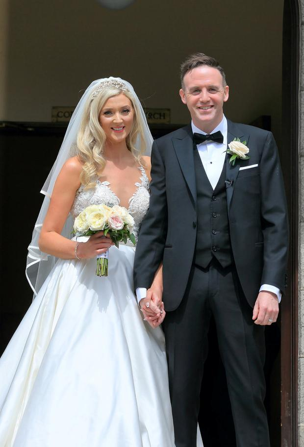 Bride Jenny Dixon pictured with groom Tom Neville TD after their wedding ceremony at Corpus Christi Church in Dublin. Picture: Frank McGrath