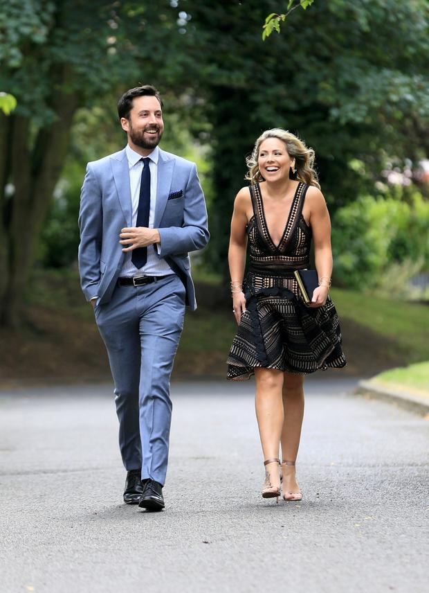 Minister for Housing,PLanning and Local Government, Eoghan Murphy pictured with his friend Chloe Townsend before Tom Neville TD married Jenny Dixon at Corpus Christi Church on Home Farm Rd in Dublin. Picture: Frank McGrath