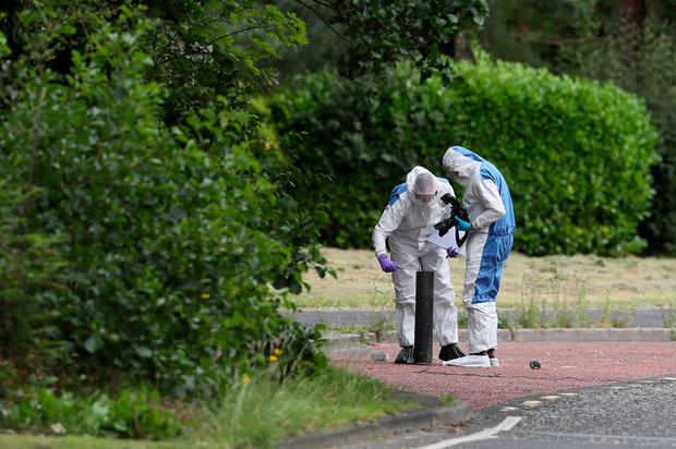 Forensic Officers in Tullygally Road, Craigavon, Co Armagh after an explosive device used by dissident republicans in a failed bid to kill police officers was discovered.: Brian Lawless/PA Wire