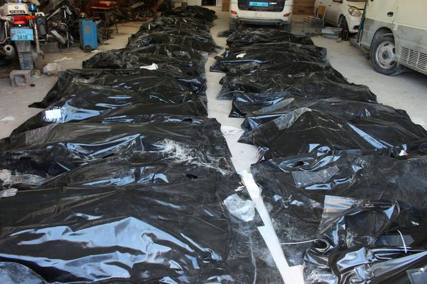 Bags containing the bodies of migrants who died after their wooden boat capsized off the coast of Komas, are seen in the hangar belonging to an anti-illegal migration department in the town east of the capital Tripoli, Libya. Photo: Ayman al-Sahili/Reuters