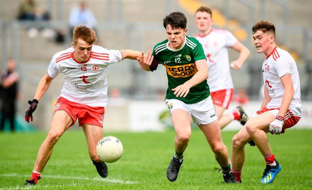 Tyrone's Aaron McGrath in action against Kerry's Gearóid Hassett. Photo: David Fitzgerald/Sportsfile