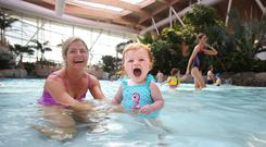 Lucy Murray (10 months) enjoys the pool with her mum Denise. Photo: Leon Farrell/Photocall Ireland