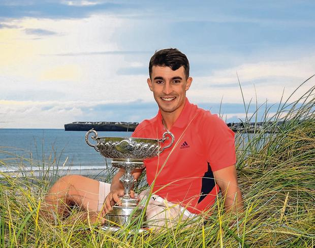 Seán Desmond shows off his South of Ireland trophy after a thrilling one-hole victory. Photo: Thos Caffrey / www.golffile.ie