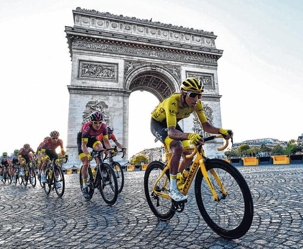 Yellow fever: Egan Bernal cruises along the Champs-Elysees to Tour de France glory. Photo: Anne-Christine Poujoulat/AFP/Getty Images