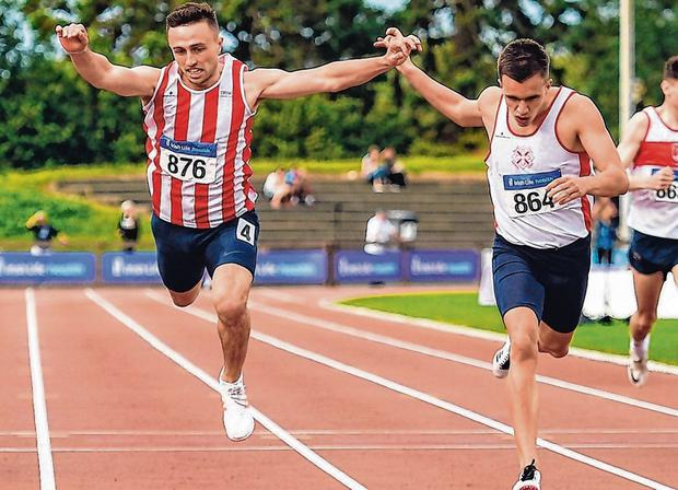Crash landing: Harry Purcell (left) dived for the finish in the 400m but it wasn't enough to beat Christopher O'Donnell, who won in 47.05. Photo: Sam Barnes/Sportsfile