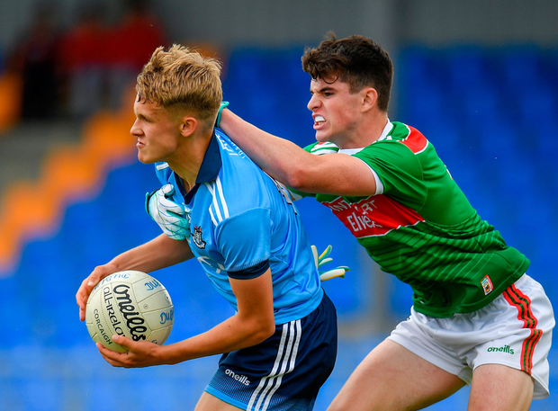 Alex Rogers of Dublin in action against Alfie Morrison of Mayo. Photo: Seb Daly/Sportsfile