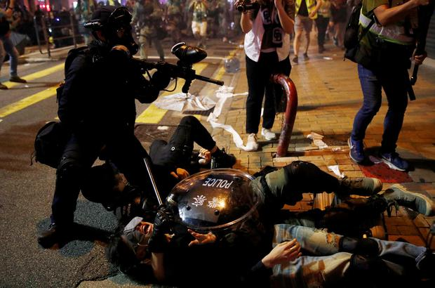 Arrest: Police detain a demonstrator during a protest near China's Liaison Office, in Hong Kong. Photo: REUTERS/Edgar Su