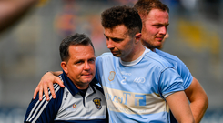 Wexford manager Davy Fitzgerald, left, is consoled by Rory O'Connor