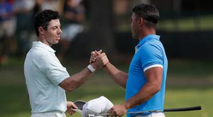 Rory McIlroy shakes hands with Brooks Koepka in Memphis