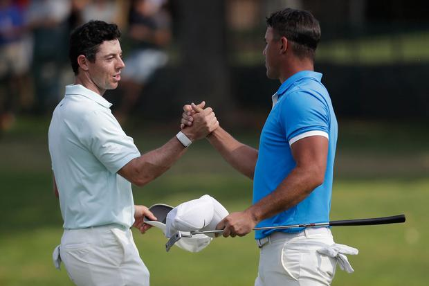 Rory McIlroy shakes hands Brooks Koepka in Memphis