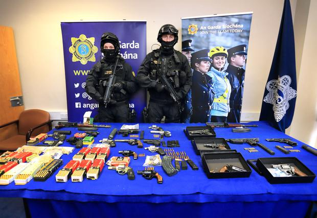 Haul: The Garda Armed Support Unit with some                       weapons that were seized by the Garda National                       Drugs and Organised Crime Bureau. Photo: Frank                       McGrath