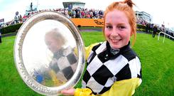 Sealed with a smile: Jockey Jody Townend with the trophy after winning the Connacht Hotel (Q.R.) Handicap aboard Great White Shark