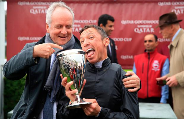 Owner Bjorn Nielsen (left) and Jockey Frankie Dettori (right) celebrate with the trophy after winning the Qatar Goodwood Cup Stakes on Stradivarius during day one of the Qatar Goodwood Festival at Goodwood Racecourse, Chichester. PRESS ASSOCIATION Photo. Picture date: Tuesday July 30, 2019. See PA story RACING Goodwood. Photo credit should read: Adam Davy/PA Wire