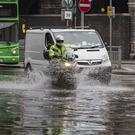 Heavy rain in Dublin led to flooding on the streets. Picture: Arthur Carron