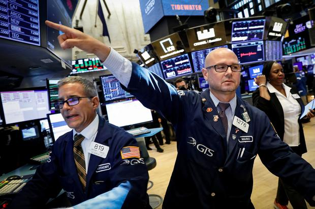 Traders work on the floor at the New York Stock Exchange. Photo: Reuters