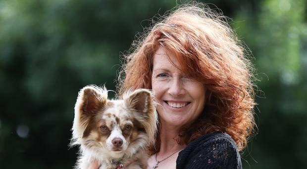 Joanne Cairns, who runs Petticoat Tails, with her dog Vernon