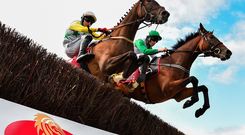 Zero Ten and David Mullins battle for supremacy with Trump Sixteen before coming out victorious in the Latin Quarter Chase. Photo: Sportsfile
