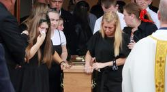 Mourners flank the remains of Aidan McMenamy after his funeral mass at St Joseph the Artisan in Bonnybrook. Picture Credit :Frank McGrath