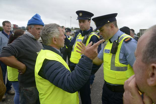 Disruption: Macroom farmer Ger Dineen and Inspector Dave Callaghan in Cork. Photo: Denis Boyle