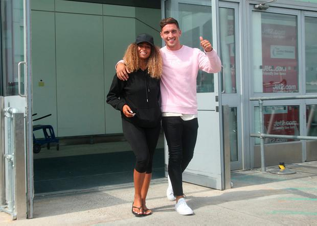 Winners: Amber Gill and Greg O'Shea arrive at Stansted yesterday after the 'Love Island' final. Photo: Yui Mok/PA Wire