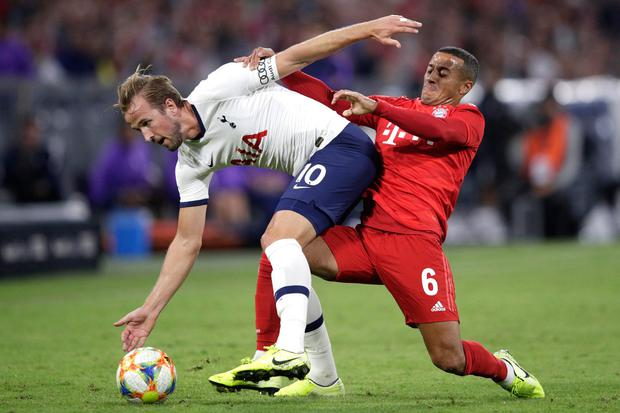 Harry Kane tussles with Bayern Munich's Thiago in the Audi Cup final, which Tottenham won 6-5 on penalties after a 2-2 draw in normal time. Dubliner Troy Parrott was an unused substitute for Spurs. Photo by Adam Pretty/Bongarts/Getty Images