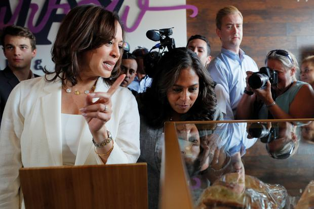 White House bid: Democratic 2020 US presidential candidate and Senator Kamala Harris and her sister and campaign chairwoman Maya ordering during a campaign visit to the Narrow Way Cafe in Detroit, Michigan. Photo: Reuters/Brian Snyder