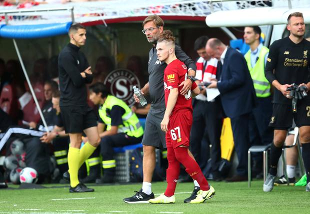 Liverpool manager Juergen Klopp with substitute Harvey Elliott against Lyon