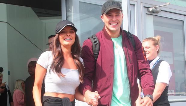Love Island contestants Maura Higgins and Curtis Pritchard arrive at Stansted Airport in Essex following the final of the reality TV show