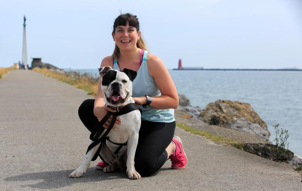 Kerry Harman from Firhouse with Rascal the bulldog enjoying the good weather in Dollymount, Dublin Photo: Gareth Chaney/Collins