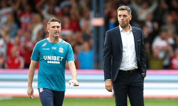 Middlesbrough manager Jonathan Woodgate (right) and coach Robbie Keane during the Sky Bet Championship match at Kenilworth Road, Luton. Photo credit: Darren Staples/PA Wire