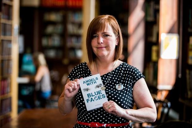 Pride: Nichola Corner with a copy of her sister Lyra McKee's posthumously published book. Picture: PA