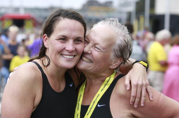 Sinead Delaney is congratulated by her mum, Joan after finishing in first place in the ladies section of the swim Picture credit; Damien Eagers / INM