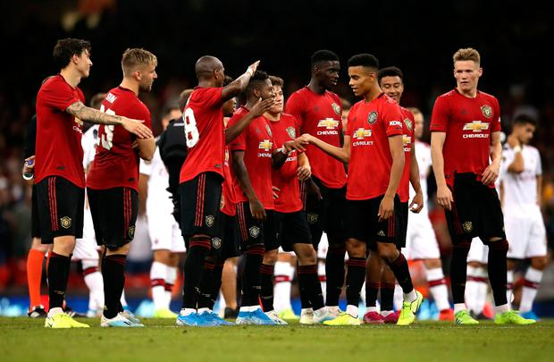 Manchester Untied's Mason Greenwood (centre) celebrates his penalty kick with team-mates