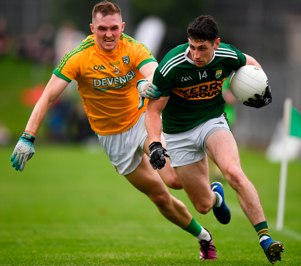 Kerry's Paul Geaney of Kerry keeps possession from Meath's Conor McGill. Photo: Sportsfile