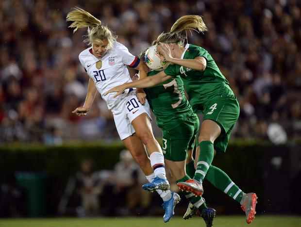 USA midfielder Allie Long (20) plays for the ball against Ireland defender Harriett Scott (3) and defender Louise Quinn (4) during the second half of the U.S. Women's National Team Victory Tour soccer match at Rose Bowl. Mandatory Credit: Gary A. Vasquez-USA TODAY Sports