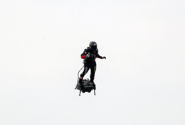 French inventor Franky Zapata lands near St Margaret's beach, Dover after crossing the Channel on a jet-powered hover-board. Steve Parsons/PA Wire