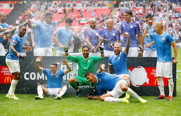 Manchester City players celebrate on the pitch after winning the Community Shield match at Wembley Stadium, London. Sunday August 4, 2019. Martin Rickett/PA Wire.