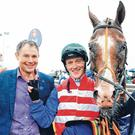 Trainer Matthew Smith and jockey Billy Lee with One Cool Poet after the horse completed his third win of the week at Galway on Saturday. Photo: PA