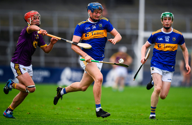 Billy Seymour of Tipperary in action against Eoin O'Leary of Wexford. Photo by David Fitzgerald/Sportsfile
