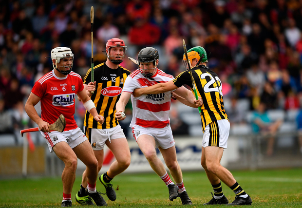 Ger Collins of Cork in action against Ciarán Brennan of Kilkenny. Photo by Harry Murphy/Sportsfile