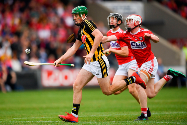 Eoin Cody of Kilkenny in action against Conor O'Callaghan of Cork. Photo by Harry Murphy/Sportsfile