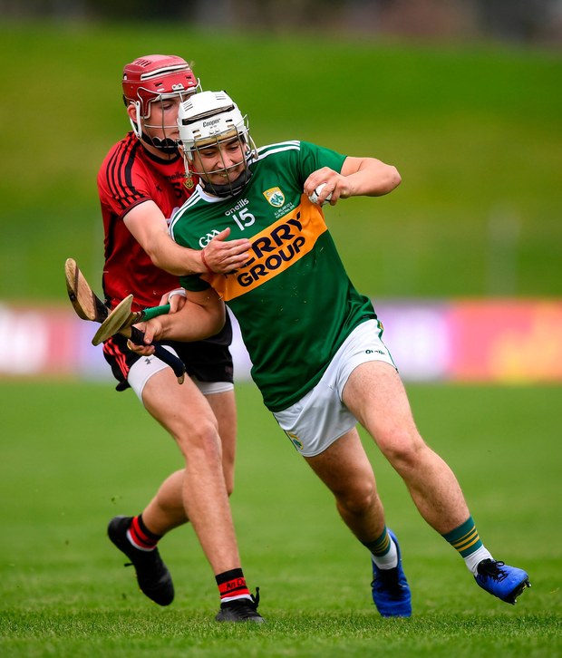 Shane McElligott of Kerry and Ciarán Watson of Down. Photo by Stephen McCarthy/Sportsfile