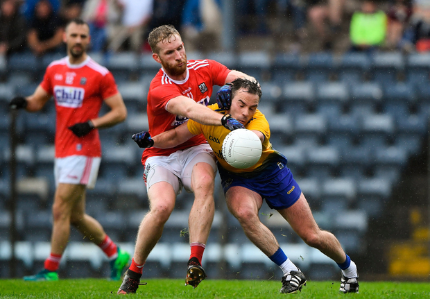 Ruairi Deane of Cork tries to dispossess Roscommon's Niall Kilroy during yesterday's clash in Páirc Uí Rinn. Photo by Matt Browne/Sportsfile