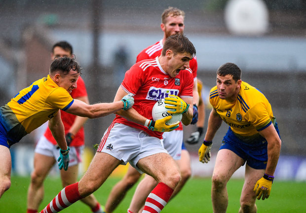 Ian Maguire of Cork in action against Aengus Lyons and Fintan Cregg of Roscommon. Photo by Matt Browne/Sportsfile