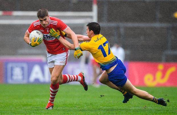 Ian Maguire of Cork in action against Colin Compton of Roscommon. Photo by Matt Browne/Sportsfile