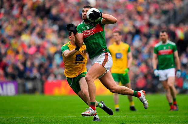 Aidan O'Shea of Mayo in action against Niall O'Donnell of Donegal. Photo by Brendan Moran/Sportsfile