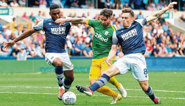 Ireland international and Preston striker Sean Maguire is tackled by Millwall's Ben Thompson and Millwall's Mahlon Romeo. Photo: Aaron Chown/PA Wire