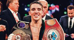 Michael Conlan shows his WBA and WBO Inter-Continental Featherweight belts after defeating Diego Alberto Ruiz at Falls Park in Belfast. Photo: Ramsey Cardy/Sportsfile