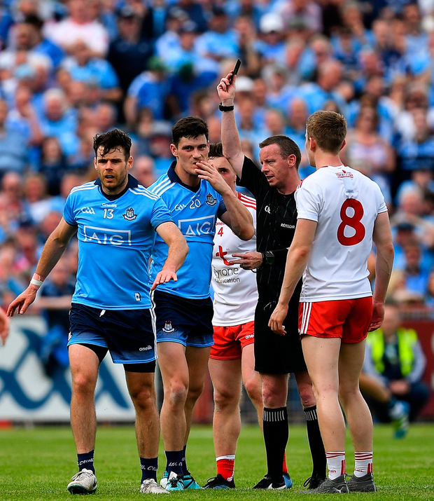 Diarmuid Connolly of Dublin is shown a black card by referee Joe McQuillan late in the second half. Photo by Brendan Moran/Sportsfile